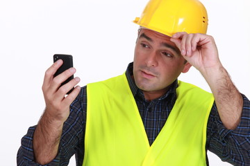 foreman with phone