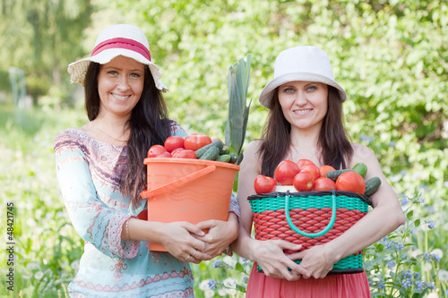 happy women with vegetables harvest