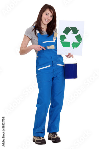 Woman holding recycle logo and paint pot