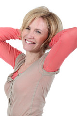 Blonde woman stretching