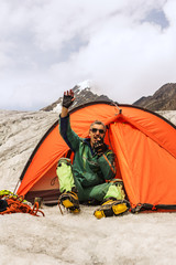 The climber in mountain camp in tent
