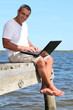 man with a laptop on holidays