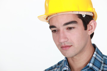 Young construction worker with a neutral expression