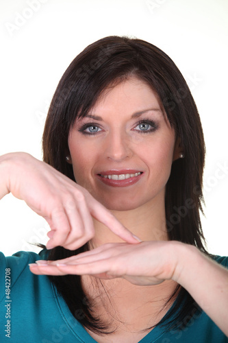 Woman pointing at own hand