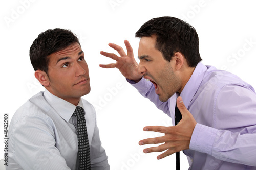 Businessman shouting at a colleague