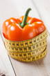 Healthy life-style concept: fresh bell pepper with a centimeter