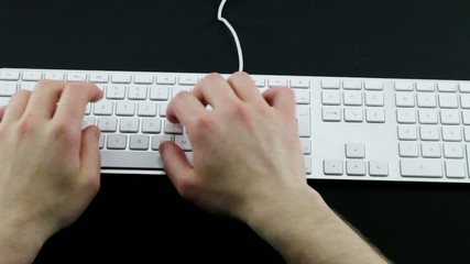 Typing on the white laptop Keyboard