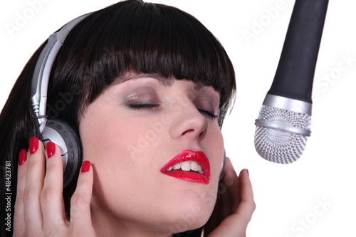 Woman singer in recording studio