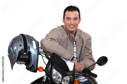 Smiling man sitting on a motorbike