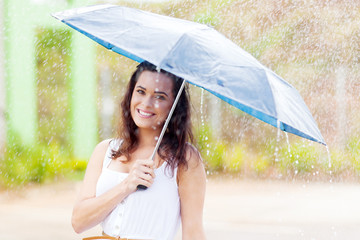 pretty young woman in the rain with umbrella