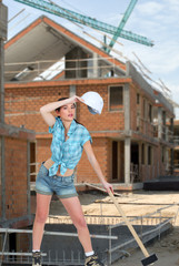 Tired female laborer at construction site