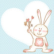 Cute love card with smiling toy bunny holding flowers