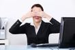 Businesswoman at office covering her eyes