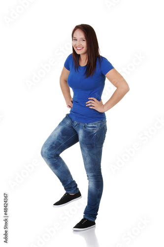 Happy casual woman with one leg up
