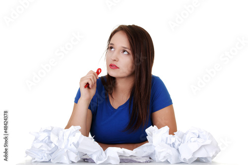 Young student woman thinking at the desk