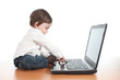 Casual baby typing on a laptop computer keyboard