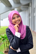Young asian businesswoman in head scarf smile