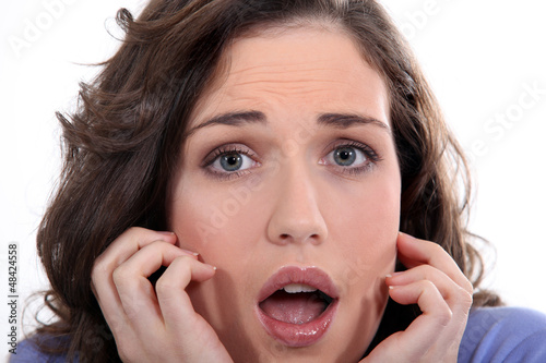 Close-up of a young woman with expression of fear