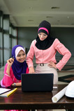 beautiful young muslim businesswoman busy at work
