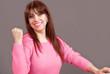 Woman power, smiling female raising fist