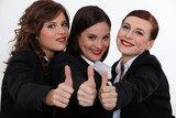 Businesswomen giving the thumb's up