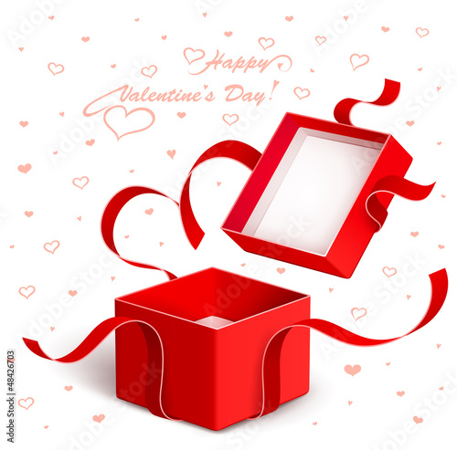 Open gift box with red ribbon torn