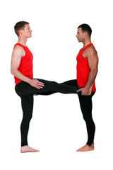 Two male gymnasts stretching