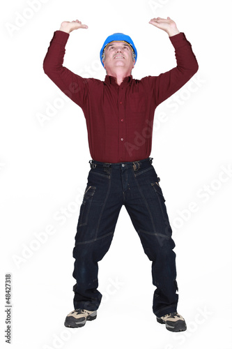 mature manual worker lifting weight