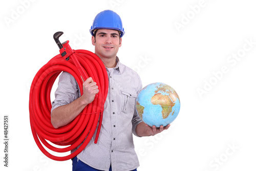 Worker with globe and wrench