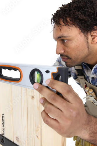 craftsman working with level
