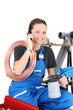 Female plumber and equipment