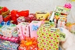 pile of Christmas gifts in colorful wrapping with ribbons agains