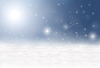Winter background with snow, snowflakes, sunshine and a blue sky
