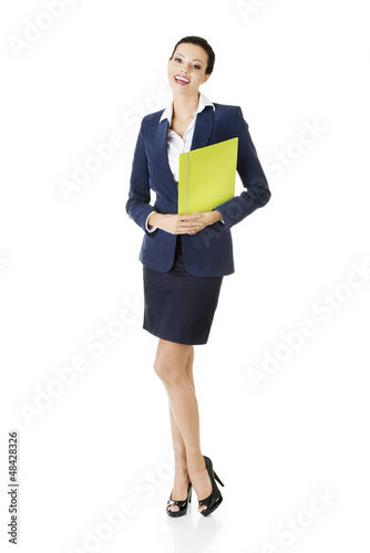 Happy businesswoman holding portfolio