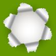 aufgerissenes Loch im Papier grün