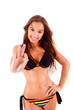 Beautiful bikini woman showing Ok sign