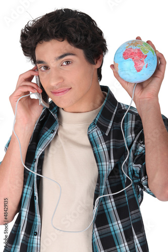 teen communicating with globe