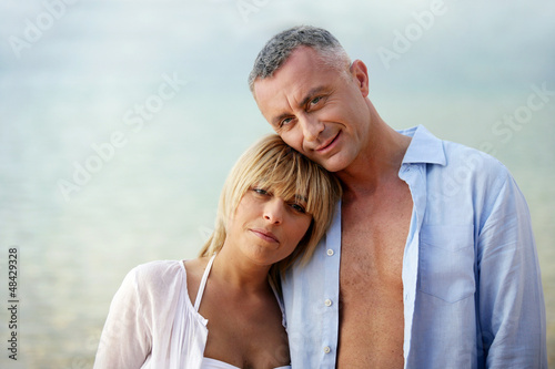 Couple wearing open shirts outdoors