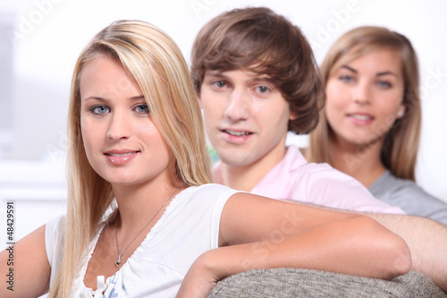 Teenage friends sitting on sofa