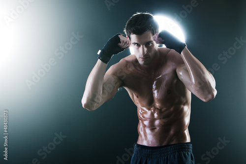 Young muscular sports guy with boxing