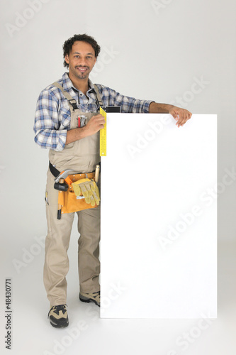 Carpenter with a try-square and board for message