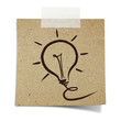 hand draw light bulb on note taped recycle paper