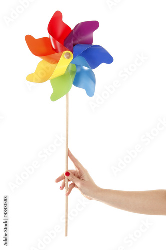 Hand is holding colorful pinwheel toy