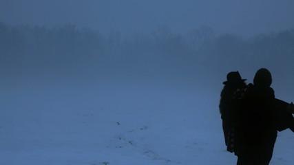 Fairy tale couple on snowfall