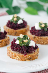 beet salad with pesto and goat cheese on toast