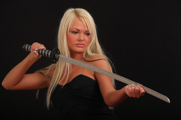 a woman with a large blade
