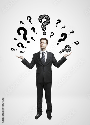 man and questions mark