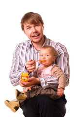 man is feeding his baby