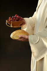 Jesus Holding Grapes and Wine