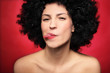 Woman with afro sticking her tongue out